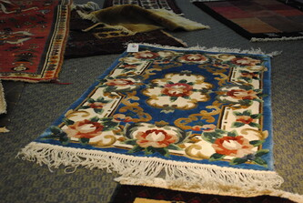 Persian rug collection with floral print for sale in rug shop.